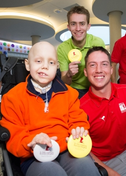 Professional disc golfers Will Schusterick (middle) and Paul Ulibarri (right) spend time with St. Jude Children's Hospital patient Luke. Photo courtesy of Biomedical Communications