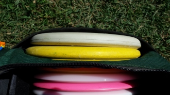 The Reptilian Disc Golf Serpent (white) and Scale (yellow) are both deep putters that make a nice one-two punch.